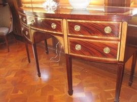 Mahogany Bow front Sideboard with double banded inlays and maple fan fronts on spade feet by Baker.