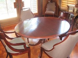 Stickley Breakfast Tablle coupled with six Malmaison Side Chairs from the Jacques Garcia collection by Baker.