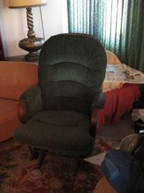 Dark Green Rocking chair, wooden frame.  EZ to move it around the rooms