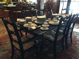 Beautiful Black Distressed Table with Iron Base  & Set of Six Lovely Black Chairs with Rush Sets