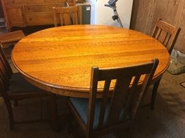 Antique Solid Oak table with four chairs.