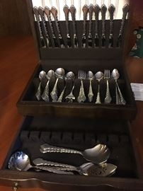 Chatelain stainless steel service for 12 with serving pieces. Never been used. In beautiful mahogany chest.  New it was $460.