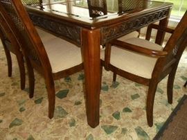 Glass mirror top dining table w/6 matching chairs and 2 extra leafs