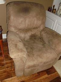 Brown rocking recliner