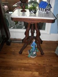 one of several marble top wood tables
