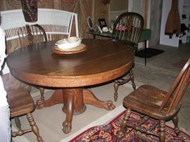Oak dining table with 4 chairs and rug