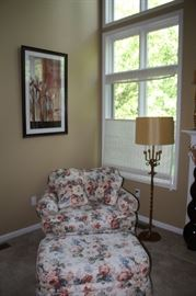 Flowered Chair & matching ottoman. large sitting area with matching small pillows.