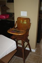 Antique child's chair which turns into a low style stroller, very cool & in great shape.