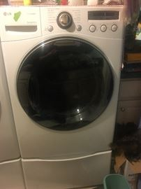 LG Washer and Dryer on pedestals