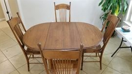Dining table with two extra leaves and 4 chairs