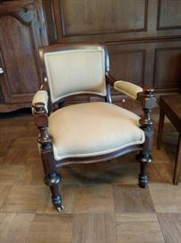One of a pair of antique armchairs