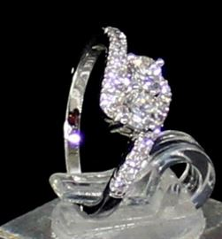 Ladies 14K White Gold Diamond Ring:   2.9 Grams Ring Size 6, 2 Center Diamonds Dia .40 ctw W/16 Side Diamonds .35 ctw. LR6