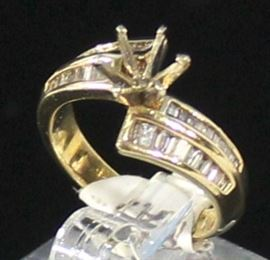 Ladies 14K Yellow Gold And Diamond Ring:  Ring Size 6 1/2, 5.2 Grams. .69 ctw Baguette Semi Mount, 44 Straight And Semi Tapered Baguettes 22 On Each Side. SI1H With 6 Prong 1 Carat W/Gold Head. LR8