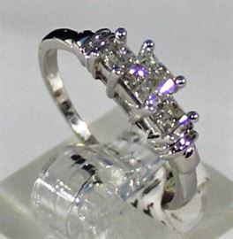 Lot 121:  Ladies 14K White Gold And Diamond Ring: 2.4 Grams Ring Size 6 1/2, 3 Princess cut Diamonds  Center Diamond is .40 ct, 2 Outer Diamonds Weighing .35 ctw I2I LR10