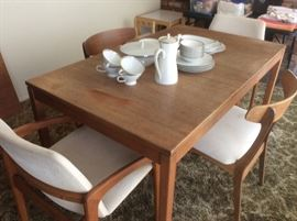 Teak dining table and four chairs