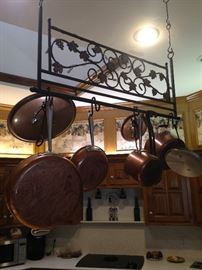 Hanging copper cookware adds a special touch to any kitchen.