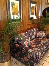 Floral loveseat from the Circle Gallery in New Orleans; matching palms in brass planters