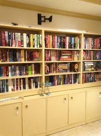 Variety of books; 3 shelf units