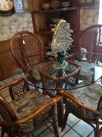 Great rattan glass top breakfast table and four cushioned chairs