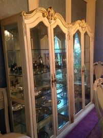 Two spacious (side-by-side) china display cabinets