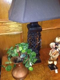 Large black lamp; copper pitcher