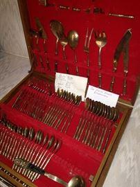Brass flatware in case