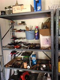 "Garage ""treasures""; shelving units"