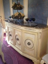 The stunning buffet matches the table and china cabinets.