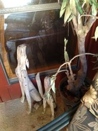 Howling coyotes made of driftwood