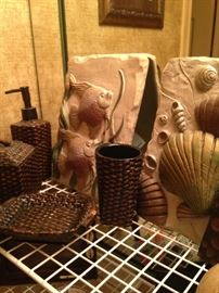Fish and shell plaques; brown woven vanity set