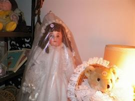 Our Great Grandmother's doll, fully restored wearing a wedding gown that was made by our Mom