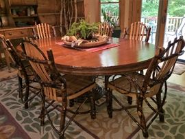 "Fabulous Woodland Table  60"" inch Round w/ 24"" Leaf  Color Light Bordeaux   also available Chairs in  Excellent Condition .     Chairs were purchased  at Woodland Creek.."