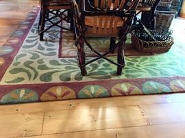 100 %  Wool   Peruvian Spice 8' X 11' Bought at the Lauren Hanna Furniture Store in TC. Excellent Cond.