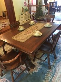Antique English oak table with pull out extensions, with 6 chairs