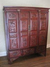 1 of 2 Oriental Carved Cupboards in red.