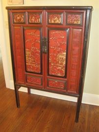 2 of 2 Oriental Carved Cupboards in red.