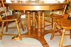 "48"" round table with five chairs and one captain's chair"