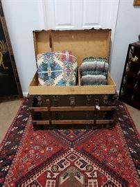 Shirez rug, vintage trunk, linens