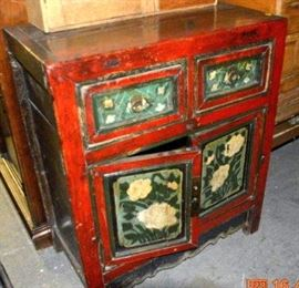 Vintaged cabinet with bold retro colors
