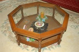 Lovely glass topped/wicker bottom coffee table