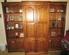 3 piece wall unit w/ center entertainment center, sold separately