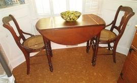Antique drop leaf table, 2 cane seat chairs