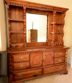 Looks like new beautiful dresser with lots of drawer space and mirror.