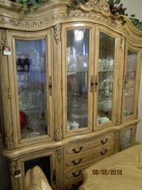 Lighted China Cabinet.  Matches the table and chairs.  Immaculate condition. 68 x 19 x 78""