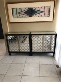 Pair of mirrored cabinets...brand new.