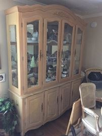 French provincial style lighted china cabinet. Two pieces. Originally purchased from Wicke's furniture in 1995.