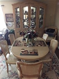 French Provencial style dining table with leaf and six chairs. Seats are covered in a white fabric which is covered in plastic. Good condition.