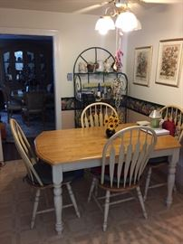 Farmhouse style kitchen table with four matching chairs. Good condition.