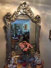 "Silver leaf wood framed ""Storybook"" mirror from Walter E. Smith furniture. Approximately 3'x4'"