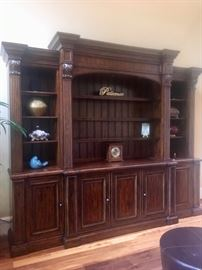 Massive bookcase/TV unit with retractable TV lift
